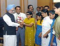 The blind girls are tying 'Rakhi' to the Prime Minister, Dr. Manmohan Singh, on the occasion of 'Raksha Bandhan', in New Delhi on August 16, 2008.jpg