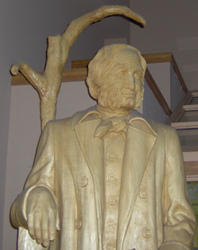 Wooden statue of a man with beard