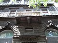 Three storey, eclectic dwelling house. Monument ID 698. By Henrik Schmahl in 1882. Windows. Putto statues.- Budapest District VI. Andrássy Ave 28.JPG