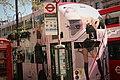 Trafalgar square... buses, bus stop, and Phone box. London.jpg