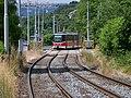Trojská, zastávka Nad Trojou, tramvaj 37 přejíždí z protisměru.jpg