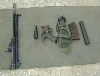 Heckler & Koch HK33 - From left to right: receiver with barrel and sights; bolt and bolt carrier assembly; pistol grip/trigger pack; return spring; stock with sling; magazine; and hand guard.