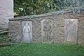 Turkovice, Kostel sv. Martina - náhrobní kameny ve zdi u kostela.JPG