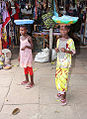 Two little girls with bowls on their heads Gambia.jpg
