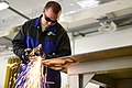 U.S. Air Force Airman 1st Class Richard Greensfelder, a metals technology journeyman with the 31st Aircraft Maintenance Squadron, welds a piece of metal April 29, 2013, at Aviano Air Base in Italy 130429-F-AI558-011.jpg