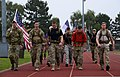 U.S. Airmen with the 48th Civil Engineer Squadron Explosive Ordnance Disposal flight participate in a 9-11 memorial 5-kilometer run-walk at Royal Air Force Lakenheath, England, Sept 140911-F-FF749-541.jpg