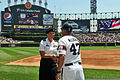 U.S. Army Capt. Jessica Beard, a human resources officer with the 85th United States Army Reserve Support Command, receives a game ball from Joe McEwing, Chicago White Sox 3rd base coach, after being recognized 130630-A-KL464-011.jpg