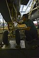 U.S. Navy Aviation Structural Mechanic 3rd Class Colin Scott, assigned to Strike Fighter Squadron (VFA) 32, performs maintenance on an F-A-18F Super Hornet aircraft in the hangar bay of the aircraft carrier USS 140102-N-CC806-053.jpg