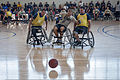 U.S. Navy and Army wheelchair basketball team members compete during the Wounded Warrior Pacific Invitational at Joint Base Pearl Harbor-Hickam, Hawaii, Jan. 9, 2014 140109-N-FF306-002.jpg