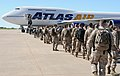 U.S. Service members at Fort Worth, Texas, board an airplane bound for Agadir, Morocco, April 5, 2012, in support of African Lion 2012 120405-A-JC300-104.jpg