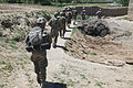 U.S. Soldiers with Baker Company, 1st Battalion, 506th Infantry Regiment, 4th Brigade Combat Team, 101st Airborne Division and Afghan National Army soldiers clear a village in Paktia province, Afghanistan 130529-A-CW939-120.jpg