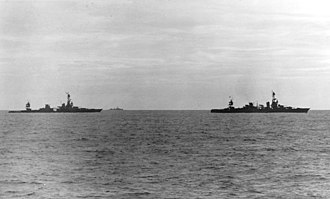 Battle of Rennell Island - USS Louisville (right) tows the crippled Chicago on the morning of 30 January 1943.