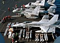 US Navy 021114-N-4748O-001 Aviation Ordnancemen prepare to load aircraft with various ordnance on the ship's flight deck in preparation for upcoming combat missions.jpg