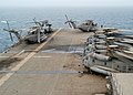 US Navy 030314-N-0068T-031 A wash down for deployed helicopters as well as the flight deck is in order after the amphibious assault ship USS Kearsarge.jpg