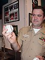 US Navy 030328-N-9643K-001 Chief Mess Management Specialist Mark Adams shows off a baseball autographed by retired Baltimore Oriole player Cal Ripken.jpg
