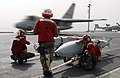 US Navy 030331-N-1810F-002 Aviation ordnancemen watch over Joint Stand-Off Weapons (JSOWs) as an S-3B Viking launches from one of four steam powered catapults aboard USS Kitty Hawk (CV 63).jpg