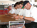 US Navy 030506-N-5821W-001 The 2002-2003 GTS Champion Corvette Racing Team, sign autographs for Sailors.jpg