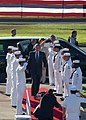 US Navy 031023-N-5024R-003 President George W. Bush accompanied by First Lady Laura Bush passes through the honor 'side-boys' during their arrival aboard Naval Station Pearl Harbor.jpg