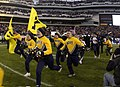 US Navy 031206-N-9693M-032 Navy Cheerleaders take to the field ahead of the navy Midshipman at the start of the 104th Army Navy Game.jpg