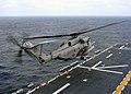 US Navy 040317-N-8606T-001 A CH-53E Super Stallion launches from the flight deck of the amphibious assault ship USS Saipan (LHA-2) during flight deck certification.jpg