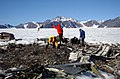 US Navy 040811-N-0331L-004 Recovery personnel examine the wreckage of a Navy P-2V Neptune aircraft that crashed over Greenland in 1962.jpg