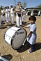 US Navy 050216-N-7923C-211 A young Indian girl, who attends the Saint Francis Xavier School for Children with Special Needs, plays a drum during a concert held by the U.S. Seventh Fleet Band.jpg