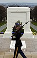 US Navy 050324-N-0295M-252 Tomb Guard Pfc. Michael Steiner marches behind the Tomb of the Unknowns during his 21-step march at Arlington National Cemetery, Va.jpg