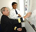 US Navy 050425-N-4729H-202 Commander, Navy Recruiting Command, Rear Adm. Jeffrey Fowler, discusses weather patterns with student Ervin Hall at the Math, Civics and Science Charter School.jpg