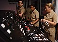 US Navy 050517-N-2000D-032 Lt. j.g. Mike Benny, left, navigation instructor at the Naval Science Institute, explains some of the components of the helmsman console.jpg