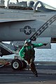 US Navy 051128-N-4321F-062 An Aviation Boatswain's Mate signals to air department personnel to ensure that an F-A-18F Super Hornet is safe to launch.jpg