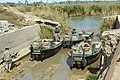 US Navy 060321-N-8252B-020 Company E, 1st Battalion, 67th Armored Regiment prepare their rib boats in order to perform a reconnaissance mission on the Musayyib Bridge.jpg