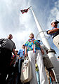 US Navy 061203-N-4774B-003 Pearl Harbor survivor, retired Capt. Jack Evans stands in front of the original flagpole on Hickam Air Force Base, which stood during the 1941 attack.jpg