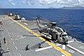 US Navy 080711-N-9500T-279 Sailors aboard the amphibious assault ship USS Bonhomme Richard (LHD 6) approach a CH-53E Sea Stallion.jpg