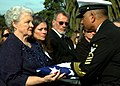 US Navy 081208-N-9604C-004 Master Chief Petty Officer of the Navy (MCPON) Joe Campa presents a flag to the family of former MCPON Thomas Sherman Crow during the memorial service at Fort Rosecrans in San Diego.jpg