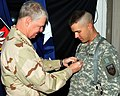 US Navy 081220-N-3377N-048 Chief of Naval Operations (CNO) Adm. Gary Roughead pins second class rank insignia on Engineering Aide 2nd Class Micah Maxted.jpg