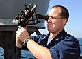 US Navy 090105-N-1082Z-015 Quartermaster 3rd Class Matthew A. James uses a sextant aboard the guided-missile cruiser USS Vella Gulf (CG 72).jpg
