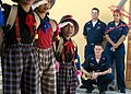 US Navy 090630-N-1722M-219 Musician 1st Class Danny McGowan, Musician 1st Class Luslaida Barbosa and Musician 2nd Class Collin Reichow, all assigned to the U.S. 7th Fleet Band, look on as students from Seberang Tayor Primary Sc.jpg