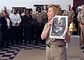 US Navy 091001-N-3731H-019 During a ceremony to commemorate the most successful year in Navy recruiting history, Rear Adm. Robin Braun, commander of Navy Recruiting Command (NRC), displays a new Navy recruiting advertisement pr.jpg