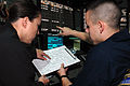 US Navy 091101-N-8960W-007 Air Traffic Controller 3rd Class Colby Wing, right, and Air Traffic Controller 2nd Class Yolonda Manny, both assigned to the aircraft carrier USS Nimitz (CVN 68).jpg