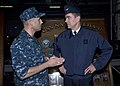 US Navy 091118-N-3592S-004 Capt. Ronald Reis, commanding officer of the amphibious assault ship USS Nassau (LHA 4), talks with French Air Force General Stephane Abrial, Supreme Allied Commander Transformation.jpg