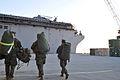 US Navy 100115-N-1831S-089 Marines ) carry gear aboard USS Bataan (LHD 5).jpg