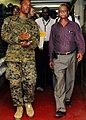 US Navy 100304-N-4378P-061 Haiti's Minister of Health, Dr. Alex Larsen, tours the Military Sealift Command hospital ship USNS Comfort (T-AH 20) with Hospital Corrpsman Christopher Brossard, a Haitian-American Sailor.jpg