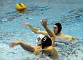 US Navy 100422-N-5366K-088 Special Warfare Operator 1st Class (SEAL) Isaiah Maring passes the ball during a water polo game with Des Moines Water Polo Club at Valley High School as part of Des Moines Navy Week.jpg