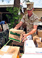 US Navy 100422-N-7526R-013 Electronics Technician 2nd Class Erik Wiberg places a box of Thin Mint Girl Scout cookies with other parcels during mail call at Camp Lemonnier, Djibouti.jpg