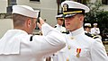 US Navy 100430-N-8848T-796 Ensign Michael O'Connor receives a first salute from Electonics Tecnician 1st Class Eric Walden.jpg