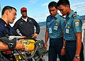 US Navy 100530-N-7643B-309 Damage Controlman 1st Class Christopher Szell explains how the oxygen tank on a self contained breathing apparatusworks to a group of Indonesian National Armed Forces sailors.jpg