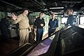 US Navy 100701-N-5319A-053 Cmdr. Jeffrey Oakey gives a tour of the ship's bridge to Cmdr. Scott Smith and Capt. Brian Nickerson.jpg