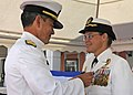 US Navy 100818-N-1512O-125 Vice Adm. Harry B. Harris, Jr., commander of the U.S. 6th Fleet, presents the Legion of Merit medal to Capt. Cindy Thebaud.jpg