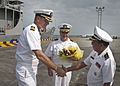 US Navy 101025-N-6770T-147 Royal Cambodian Navy Rear Adm. Ros Veasna, right, welcomes U.S. Navy Capt. David Welch, left, commander of Task Group 73.jpg