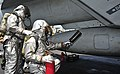US Navy 110410-N-0074G-164 Sailors fight a simulated fire of an aircraft after an emergency landing aboard USS Enterprise (CVN 65).jpg